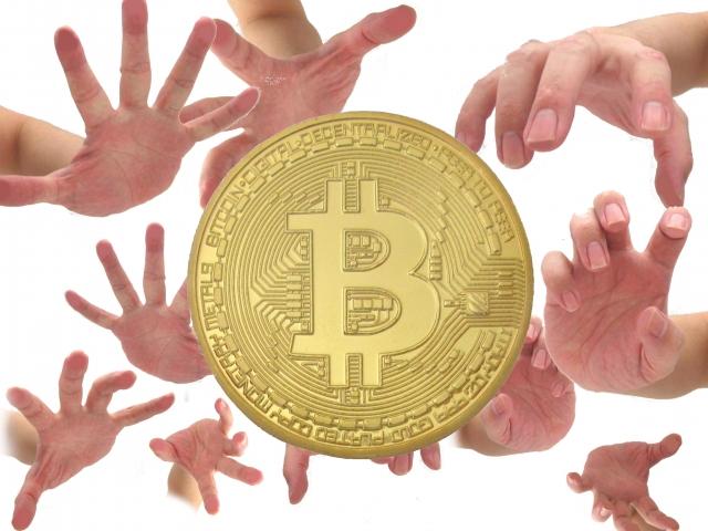 ビットコインとそれを狙う人の手
